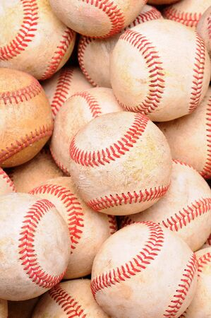 vertical format: Closeup of a pile of old used baseballs in vertical format. Stock Photo