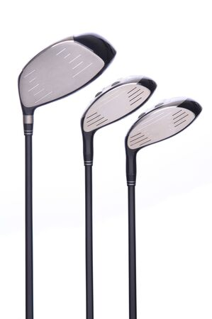 equipment: Set of three golf Wood clubs on a white background with reflection.