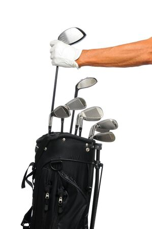 Golfer removing his driver from a black golf bag. Only Golfers arm and hand with glove are showing. Isolated over a white background.