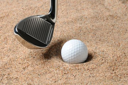Golf Ball in Trap with Sand Wedge about to strike the Golfball. Close up in horizontal composition with copy space. Stock Photo - 7753946