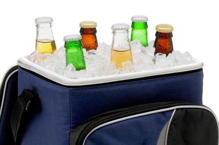 Six assorted beer bottles in a soft sided cooler or ice chest. Close up inh orizontal format isolated over white. Stock Photo