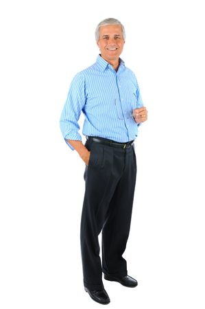 old man standing: Smiling middle aged businessman standing with one hand in his pocket and the other holding his eye glasses. Full length over a white background.