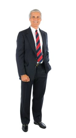 Smiling middle aged businessman in a suit and tie standing with one hand in his pocket and the oter buy his side. Full length over a white background.