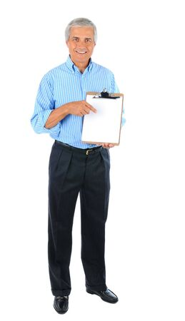 Smiling middle aged businessman standing pointing at a clipboard with a blank piece of paper. Full length over a white background. Stock Photo - 7988809