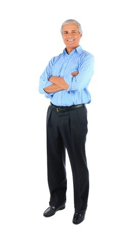 old man standing: Smiling middle aged businessman standing with his arms folded. Full length over a white background. Stock Photo