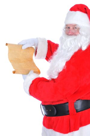 Santa Claus unrolling his naughty and nice list. Isolated on white in vertical format. photo