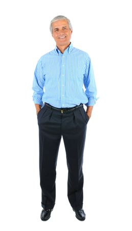Smiling middle aged businessman standing with his hands in pockets. Full length over a white background. Banque d'images
