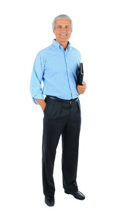 aged: Middle aged businessman with one hand in pocket and a notebook under the other arm. Man is smiling and standing. Full length shot isolated over white