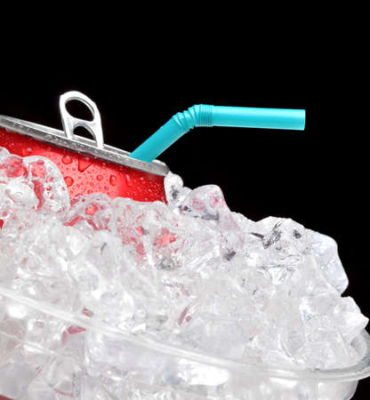 Close up of a red soda can in a bucket of ice with a blue straw. Black background with shallow depth of field focus is on can and straw. Stock Photo - 8176458