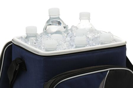 ice chest: Water bottles in a soft sided cooler or ice chest. Close up in horizontal format isolated over white. Stock Photo