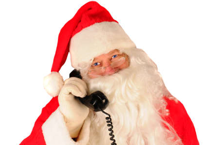 Close up of Santa Claus with retro telephone held up to his ear isolated on white. Stock Photo - 8341614