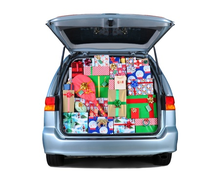 excessive: Minivan with its rear door open and stuffed full with wrapped Christmas presents. Square format isolated on white with shadow under vehicle.