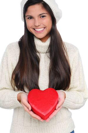Smiling Young Woman Holding Valentine's Day Candy Heart Box in front of her body. Vertical Format isolated on white. Stock Photo - 8581591