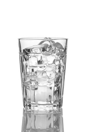 icecube: Close up of a glass of water or vodka with ice cubes. Vertical Format isolated on white with reflection.