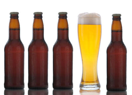 Four Brown Beer Bottles and a Full Glass of ale on a white background. Stock Photo - 9038156