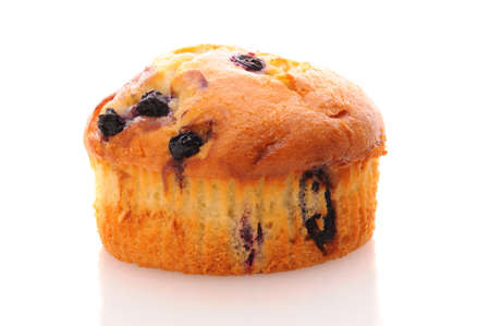 blueberry muffin: Closeup of a Blueberry Muffin on a white surface with reflection. Stock Photo