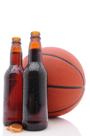 Two open beer bottles and a basketball on a white background with reflection. Vertical format from a low angle. Stock Photo - 9207534