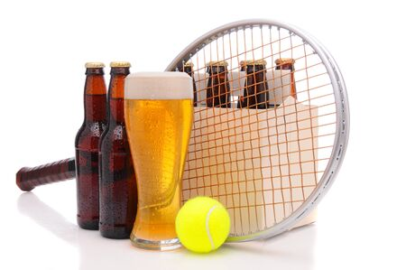 Six pack of beer and frothy glass with a tennis racket and ball in front. Horizontal format isolated on white with reflection.