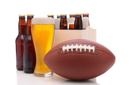 6 pack beer: Six pack of beer and frothy glass with an American Football in front. Horizontal format isolated on white with reflection.