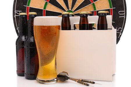 6 pack beer: Six pack of beer and frothy glass with a Dart Board and Darts. Horizontal format isolated on white with reflection. Stock Photo