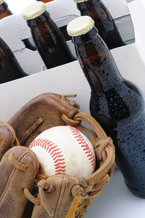 6 pack beer: Closeup of a Six Pack of Beer and Baseball Glove.  Stock Photo