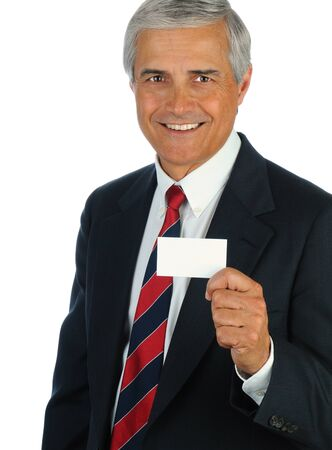 Portrait of a smiling middle aged business man holding a blank business card in front of his body. Vertical format isolated on white. photo