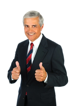 thumb's up: Portrait of a smiling senior business man with a two thumbs up hand gesture. Vertical format isolated on white. Stock Photo