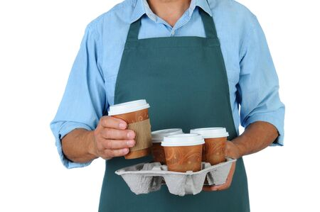 disposable: Barista holding a take out tray of disposable coffee cups. Torso only in horizontal format isolated on white.