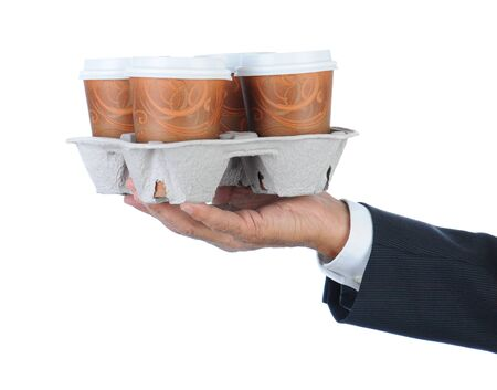 take out: Business man holding a take out tray of disposable coffee cups. Arm only in horizontal format isolated on white.