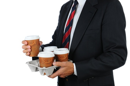 Business man holding a take out tray of disposable coffee cups. Torso only in horizontal format isolated on white. photo