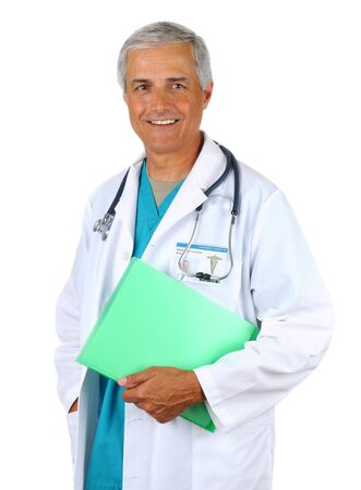 50 yrs: Smiling middle aged doctor holding a patients chart. Man is wearing a lab coat and scrubs with  stethoscope around his neck. Vertical format on a white background.