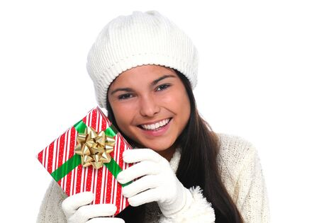 Attractive smiling young woman holding a Christmas present near her face. Closeup in horizontal format over white. Stock Photo - 9961101