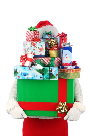 Attractive smiling young woman carrying a large stack of Christmas presents. The stack of gifts hides the persons identity. Closeup in vertical format over white. Stock Photo - 10043695