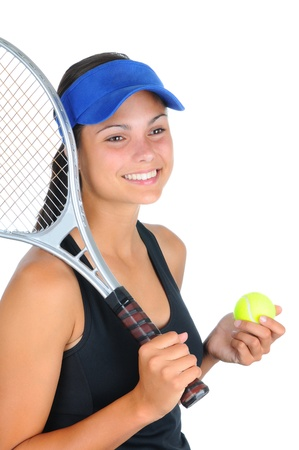 Closeup of an attractive young female tennis player with racket over her shoulder and a ball in her other hand. Vertical format isolated on white. photo