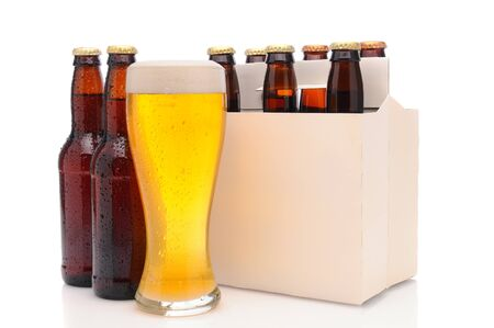 Six pack of beer and frothy glass. Horizontal format isolated on white with reflection. Stock Photo