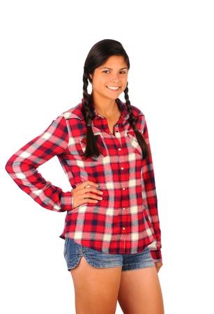 chemise carreaux: Smiling Teenage Girl en chemise � carreaux et un short en jean, debout, la main sur sa hanche. Format vertical isol� sur blanc.