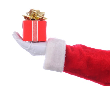 st  nick: Santa Claus outstretched arm holding a red present with a gold bow in his hand. Horizontal format over a white background.