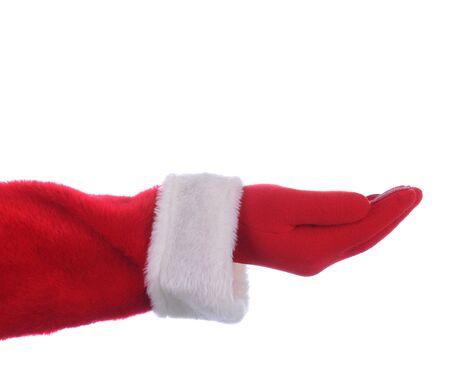 Santa Claus uitgestrekte arm met zijn handpalm naar boven gericht. Horizontale formaat op een witte achtergrond.