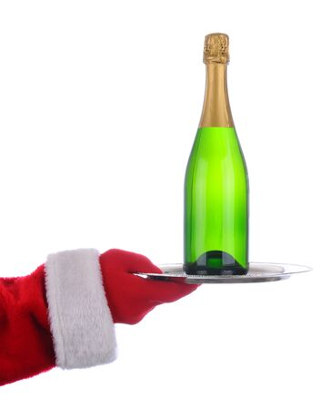 st  nick: Santa Claus outstretched arm holding a Champagne Bottle on  a serving tray. Vertical format over a white background.