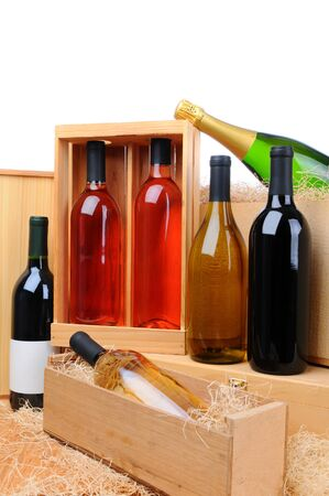 An assortment of wine bottles on wooden crates. Vertical format. photo
