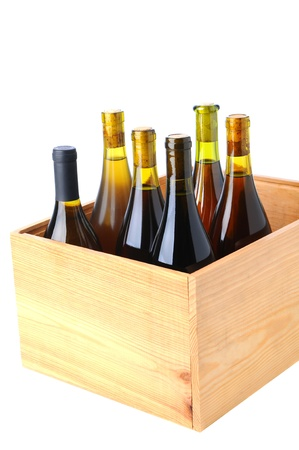 Six bottles of Chardonnay wine Standing up in a wooden case over a white background photo