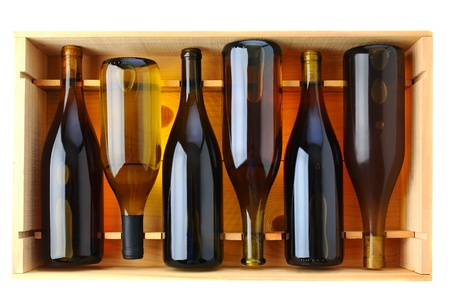 Six bottles of Chardonnay wine in a wooden case, view from above over a white background.