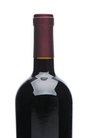 白地に赤ワインの瓶のクローズ アップ 写真素材