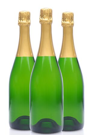 white wine bottle: A group of three Champagne bottles without labels over a white background. Stock Photo