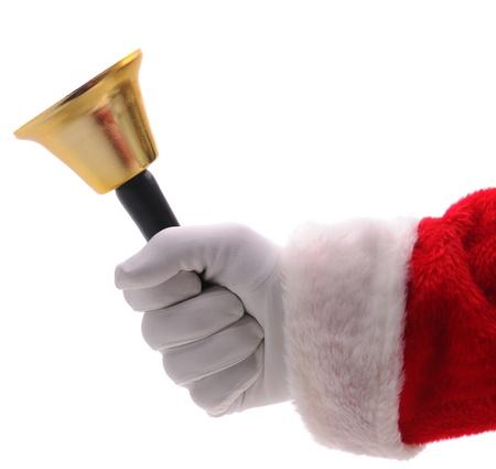 campanas: Cerca de Santa Claus toca una campana de oro. Mano y el brazo s�lo aislado m�s de blanco.