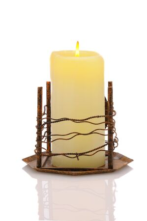 Candle in metal holder over a white background photo