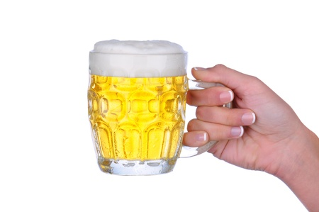 Closeup of a womans hand holding a beer mug over a white background. Stock Photo - 11875997
