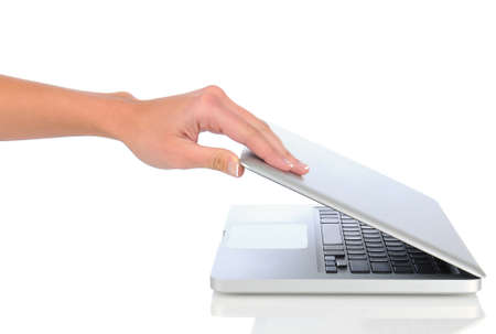 Closeup of a woman's hand opening her laptop computer over a white background. Stock Photo - 11876002