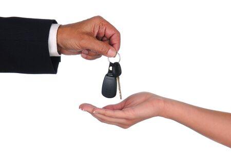 car keys: Closeup of a car salesman dropping keys into a woman Stock Photo