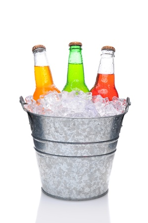 soda bottle: Three assorted soda bottles in a bucket filled with ice. Vertical Format over a white background with reflection Stock Photo